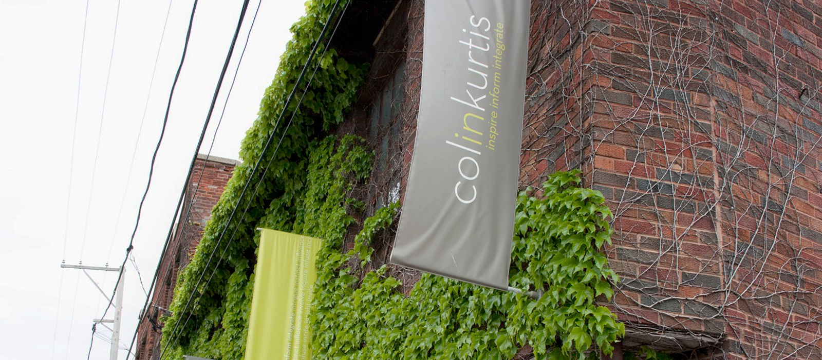 Brick office building with ColinKurtis banner