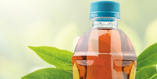 bottle of iced tea with tea leaves