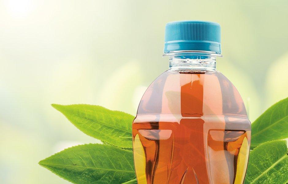 bottle of iced tea with tea leaves