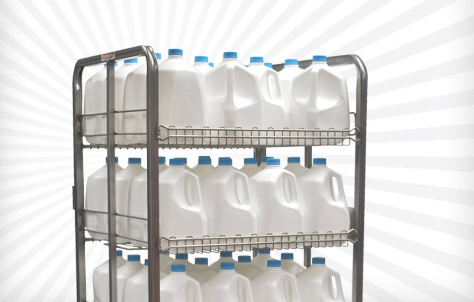 gallons of milk on metal shelves